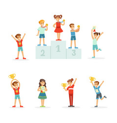 Happy young children holding their golden trophies vector
