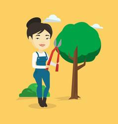 Farmer with pruner in garden vector
