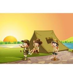 Thee kids camping out in the field vector image