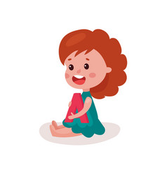 adorable redhead little girl sitting on the floor vector image