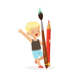 cute blonde little boy holding giant red pencil vector image
