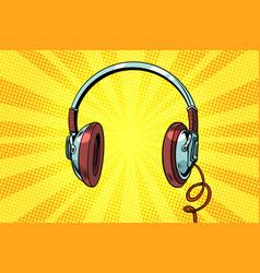 Retro headphones on a yellow background vector