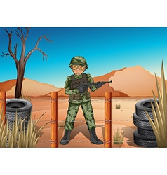 A soldier holding a gun vector