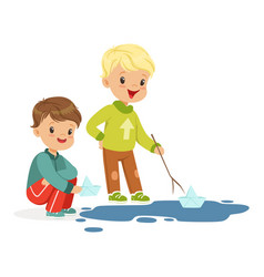 cute little boys playing with paper boats in a vector image