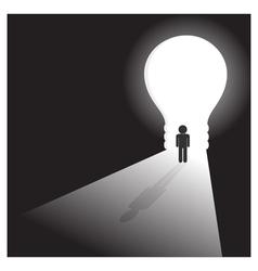 Businessman in front of a bright light bulb door vector
