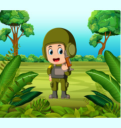 A soldier carrying gun at the jungle vector