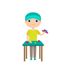 Boy building toy house or tower from lego blocks vector