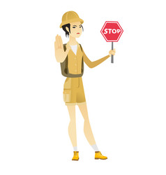 Asian traveler holding stop road sign vector