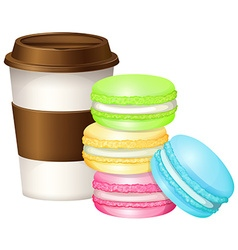 Coffee cup and colorful macaron vector