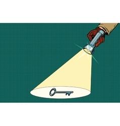 Detective flashlight beam shines on key vector image