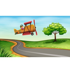 A plane above the winding road vector