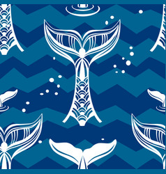 Seamless pattern with whales tail vector