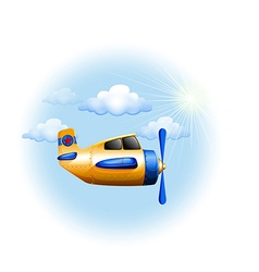 A yellow vintage plane in the sky vector