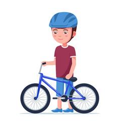 Boy stands with a bmx bike vector