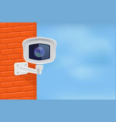 security camera on red brick wall with blue sky vector image