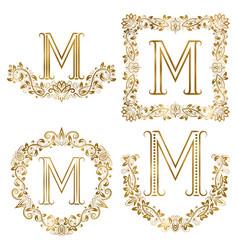 Golden m letter ornamental monograms set heraldic vector