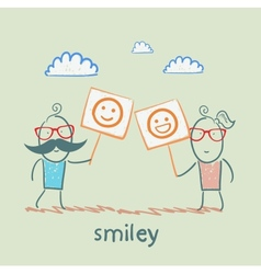 man and girl holding posters with fun emoticons vector image vector image