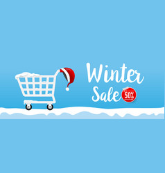 winter sale calligraphy text with shpping cart vector image
