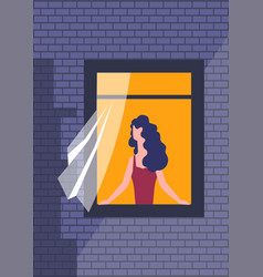 woman in window with curtain night time brick wall vector image