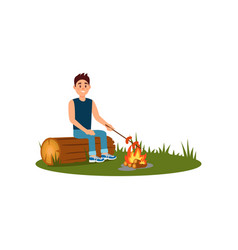 young smiling man sitting on log and cooking vector image