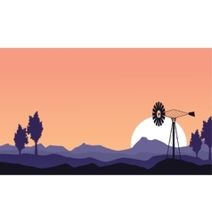 At sunset windmill silhouette scenery vector