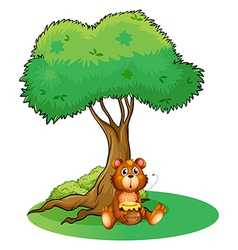 A bear sitting under a big tree vector image vector image