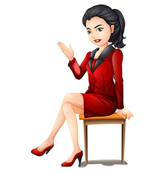 A professional woman sitting down vector