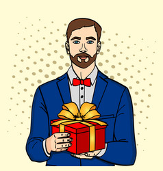 man holds big gift box in retro comic pop vector image