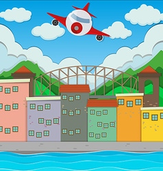 Airplane flying over the town vector