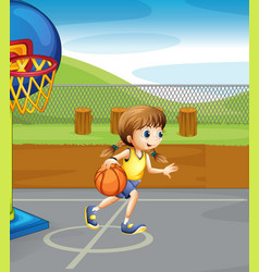 Girl playing basketball in the court vector