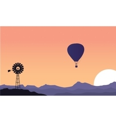 Silhouette of windmill and air balloon scenery vector image