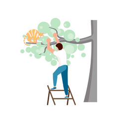 man is climbing up the ladder to save a ginger cat vector image