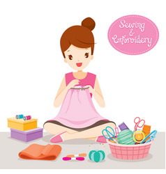 Woman sewing clothes by hand in embroidery hoop vector