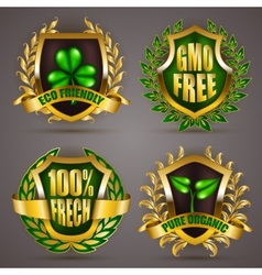 Golden badges with laurel wreath vector