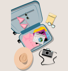 overhead shot opened suit case filled with vector image