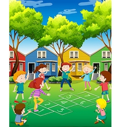 Children playing hopscotch in the yard vector image