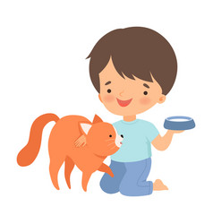 Little boy stroking cat and putting down bowl vector