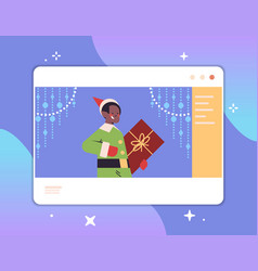 boy elf holding gift box in web browser window vector image
