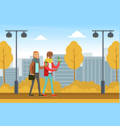 two male friends walking and chatting in autumn vector image