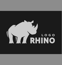 african rhino silhouette logo symbol on a dark vector image