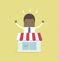African businessman standing behind the shop vector