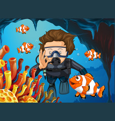 scuba diver diving underwater with clownfish vector image