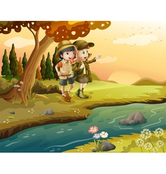 A girl and a boy at the riverbank vector