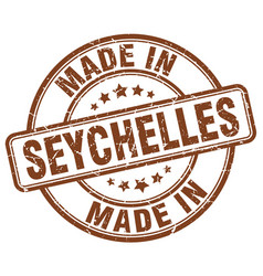 made in seychelles brown grunge round stamp vector image