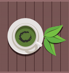 design of cup of green tea and green leaves vector image