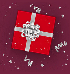 a realistic red gift box decorated with a silver vector image
