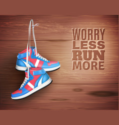 pair of leather sports shoes on wood background vector image vector image