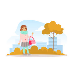 cute girl walking with bag in autumn city park vector image