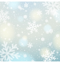 Blue background with white blurred snowflakes vector image