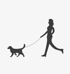 silhouette of woman walking a dog vector image